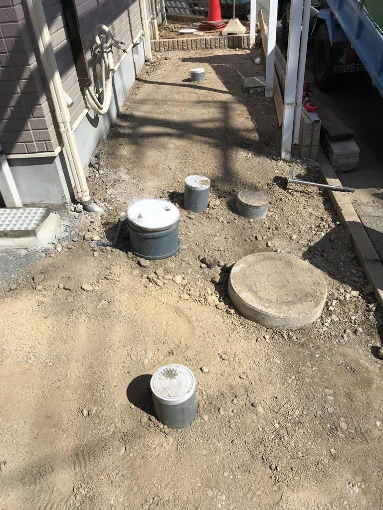 公共下水道接続工事整地転圧状況写真